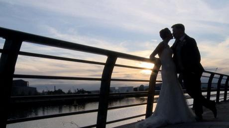 on the end of the wedding video the bride and groom have a kiss before the sun sets in Salford
