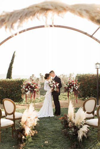 pampas grass wedding aisle with arch and flowers for ceremony ashley bee photo