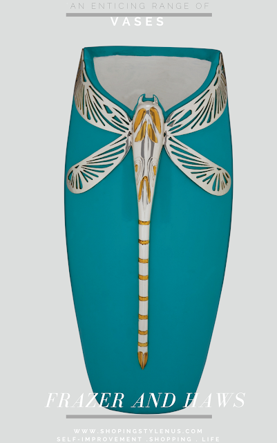 A tasteful resin vase in aquamarine colour duco on the outer surface and white duco on the inner surface is an artistic decorative piece. The dragon fly's form is chased in silver with gold gilded detailing and the wings are in piercing technique. Price: INR 15,200