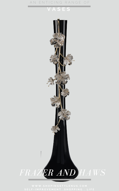 A porcelain vase in black with silver plated vine and floral blossoms. INR 14,900