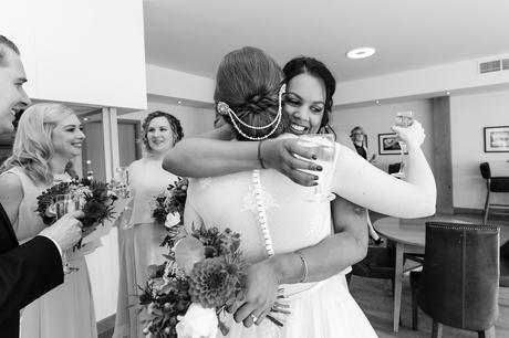 Bride hugs the guests