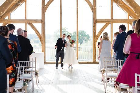 Sandburn Hall Wedding Photography bride and groom walk back up the aisle