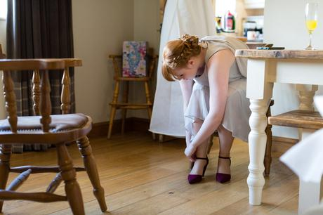 Bride's sister tying up her shoes Yorkshire Wedding Photography