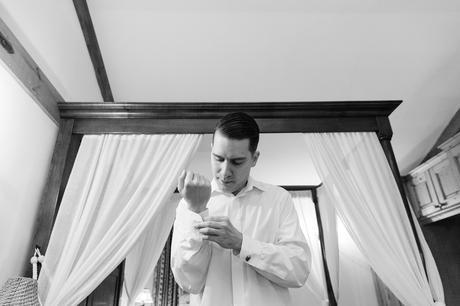 Sandburn Hall Wedding Photography Groom buttoning his shirt