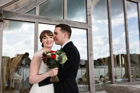 Sandburn Hall Wedding Photography groom kisses bride on cheek