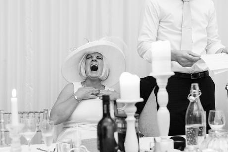 Fun Wedding Photography in Yorkshire brides mom laughs a big laugh during speeches