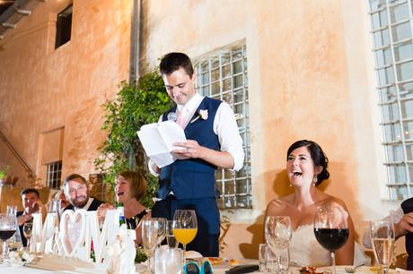 Fun Wedding Photography in Yorkshire Bride laughs as groom gives speech