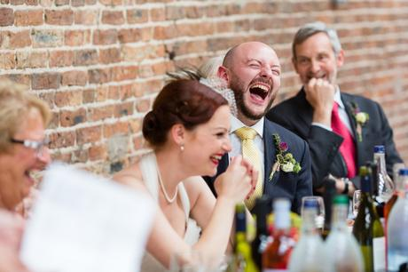 Fun Wedding Photography in Yorkshire groom laughs during speeches