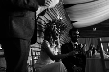Bride laughs during speeches Fun Wedding Photography in Yorkshire