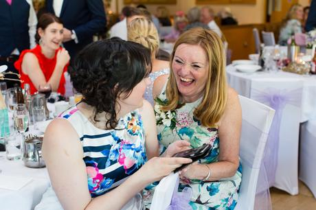 Fun Wedding Photography in Yorkshire guest laughs and smiles during speeches