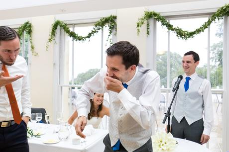 Fun Wedding Photography in Yorkshire groomsmen do cinnamon challenge