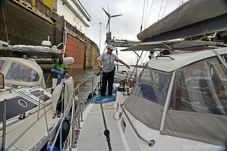 Panama Canal advisor directing boats