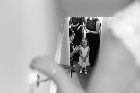Family looking on as bride walks down the stairs Bell Hall Wedding Photography