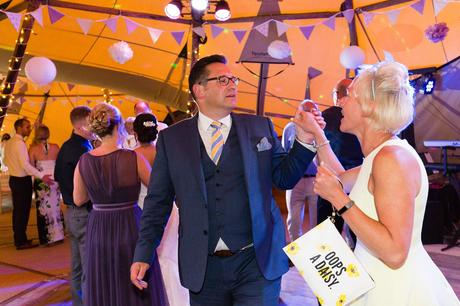 Guests dancing at tipi wedding