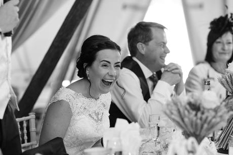 Bell Hall Wedding Photography speeches inside the tipi bride laughing