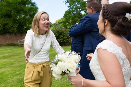 Bell Hall Wedding Photography guests hugging and saying hello to the couple big smile