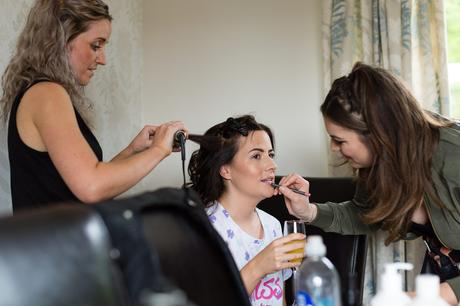Bell Hall Wedding Photography bride having both hair and makeup done at the same time.