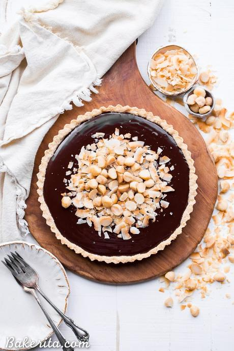 This Dark Chocolate, Coconut & Macadamia Nut Tart is decadent, delicious and easy to make. It has a coconut crust that's filled with a luscious chocolate ganache and topped with toasted coconut and macadamia nuts.You'd never guess that this nutty tart is gluten-free, vegan, Paleo, and refined sugar-free!