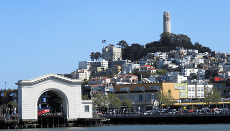 A view of SFO's buildings with the Coit tower in the backdrop
