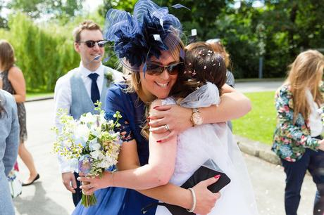 East Riddlesden Hall Wedding Photography guests hugging brides