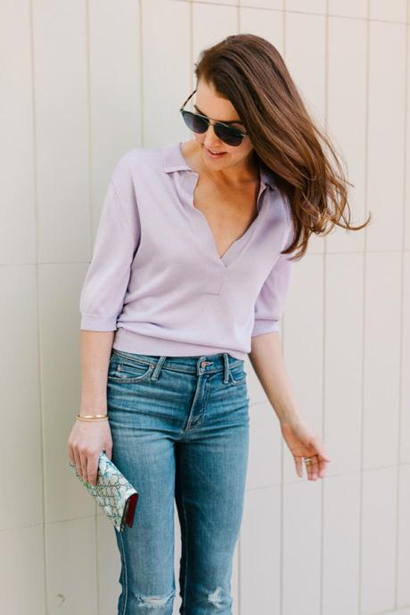 Amy Havins wears a purple tiki top and jeans.