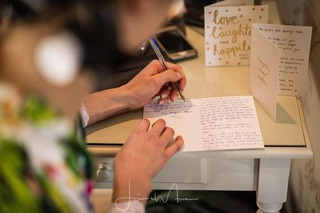 Bride writing card to her Groom
