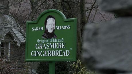 the bright green Grasmere Gingerbread shop with a picture of sarah Nelson on