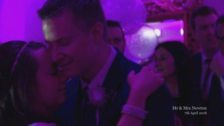 guests sing along behind the couple as they have their first dance during their wedding reception in the lake district