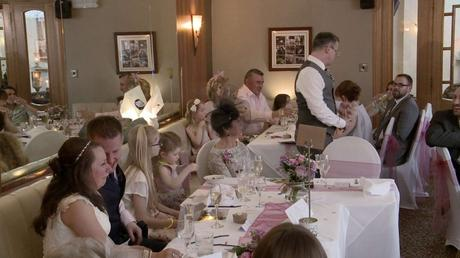 the best man has everyone laughing during his speech on the wedding video at The Wordsworth hotel in grasmere