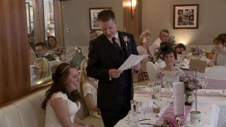 the groom looks down at his bride as he shares his wedding speech with guests at the Wordsworth Hotel