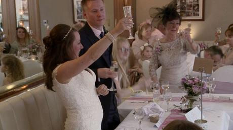 the bride raises her champagne glass to toast her wedding guests during speeches at the wordsworth hotel