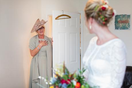 Yorkshire Wedding Photographers at Barmbyfield Barn brides mom sees bride for first time.