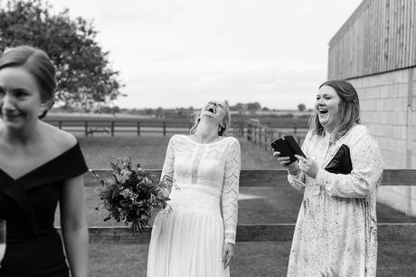 Barmbyfield Barn Wedding Photography bride laughing her head off