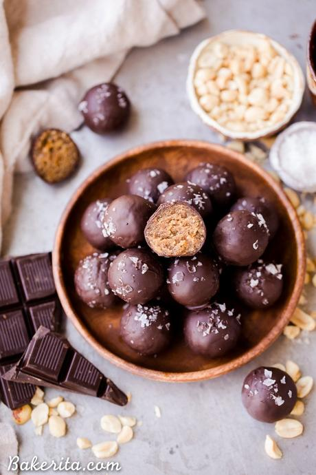 These ChocolatePeanut Butter Truffles are decadent, delicious, and made with just FOUR super simple + clean ingredients. They're gluten-free, vegan and sweetened with dates - they can also easily be made paleo by using a different nut butter! These truffles are sure to satisfy your chocolate peanut butter candy cravings.