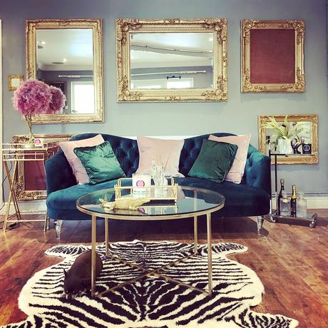 House tour- opulent and eccentric décor. Glam, gold living room with velvet sofa and zebra rug.