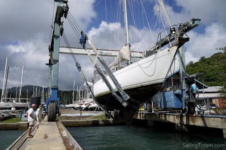 sailboat in travel lift slings