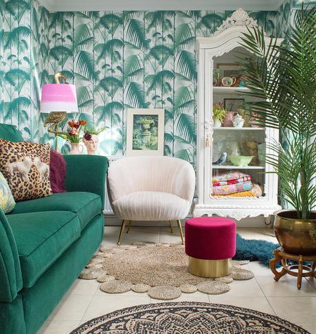 Tropical living room inspiration featuring Cole & Son wallpaper, a stunning green velvet sofa, and blush pink velvet armchair.