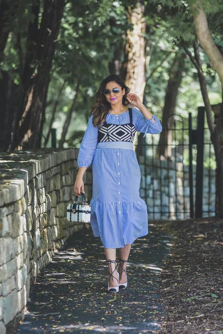 Seersucker dress, fashion blogger, stripes dress, vested, crop top layering outfit. street style, ray ban sunglasses. aldo sporty heels, box clutch bag, myriad musings