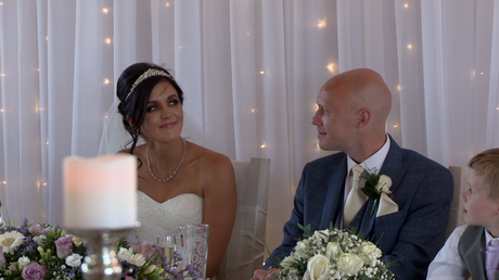 the bride tries not to cry during her dads father of bride speech at the blue mallard