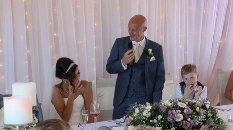 the bride laughs as she wipes away her tears during the grooms speech at the blue mallard