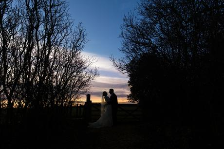 York Wedding Photography at Hornington Manor Farm Sunset Photograph at back gates silhouette