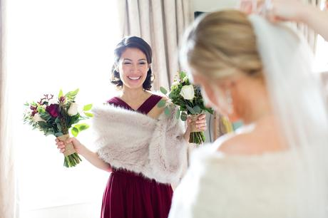 Bridesmaid holds flowers