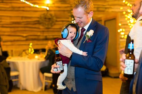 Baby with ear defenders on at York Wedding Photography at Hornington Manor Farm