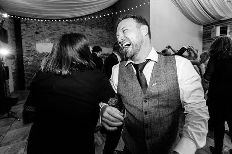 York Wedding Photography at Hornington Manor Farm groom smiles whilst dancing