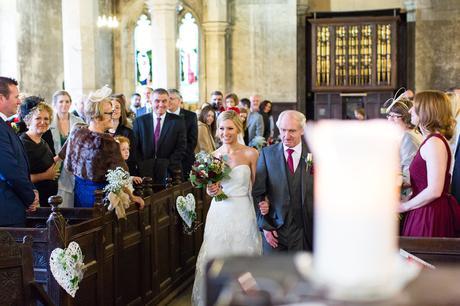 Bride walks up the aisle at church