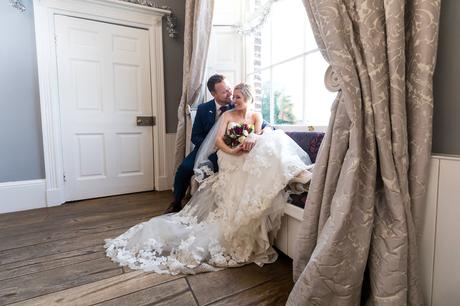 York Wedding Photography at Hornington Manor Farm bride and groom sit in window seat