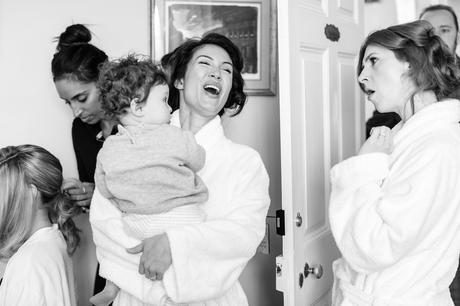 Flower girl's mother hugs her and smiles at York Wedding