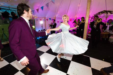 Bride and groom dance on black and white chequerboard dance floor
