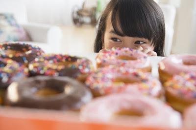 Child looking at Doughnuts