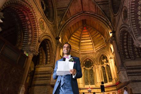 Groom gives speech with church background St Stephens Hampstead Heath Wedding Venue